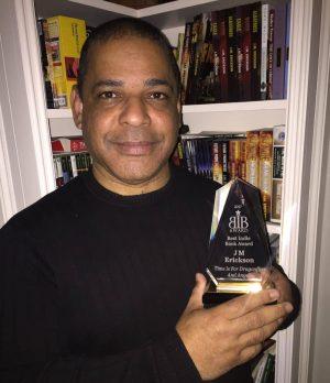 J.M. Erickson With Award